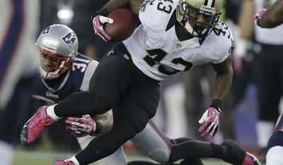 New England Patriots defensive back Nate Ebner (43) runs past New England Patriots cornerback Aqib Talib (31) in the third quarter of an NFL football game Sunday, Oct.13, 2013, in Foxborough, Mass. (AP Photo/Steven Senne)