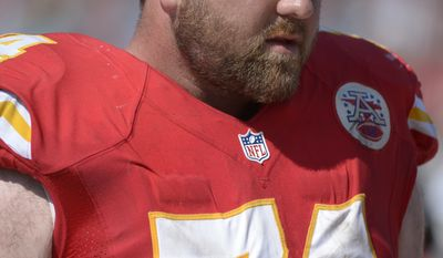 Kansas City Chiefs tackle Geoff Schwartz (74) watches from the bench during the second half of an NFL football game against the Jacksonville Jaguars in Jacksonville, Fla., Sunday, Sept. 8, 2013.(AP Photo/Phelan M. Ebenhack)