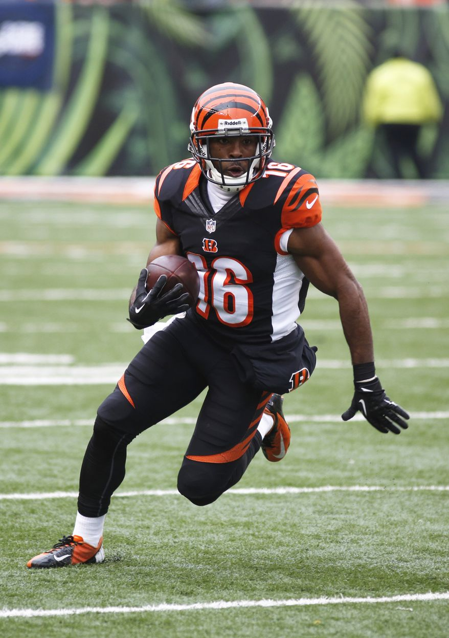 Cincinnati Bengals wide receiver Andrew Hawkins runs against the Baltimore Ravens in the first half of an NFL football game, Sunday, Dec. 29, 2013, in Cincinnati. (AP Photo/David Kohl)