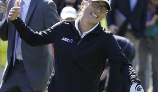 Lydia Ko of New Zealand reacts after shattering a pane of glass in a skills competition during media day for the Swinging Skirts LPGA Classic golf tournament at Lake Merced Golf Club Monday, March 10, 2014, in Daly City, Calif. The event, which is in April,  marks the return of the LPGA to the San Francisco Bay area for the first time in four years. The event is the first LPGA event in the U.S. led by a Taiwanese organization. (AP Photo/Eric Risberg)