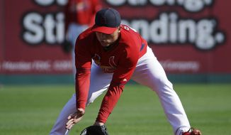 St. Louis Cardinals' Aledmys Diaz takes practice on the field before the start of an exhibition spring training baseball game against the Detroit Tigers, Monday, March 10, 2014, in Jupiter, Fla. Diaz reported to spring training Monday after the Cardinals signed the Cuban free agent shortstop to a major league contract. The Cardinals were among a number of teams, including the Yankees, who held private workouts for the right-handed hitting Diaz and the deal is believed to be for $15-20 million for four years. (AP Photo/David Goldman)