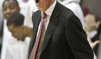 San Diego State coach Steve Fisher gets excited during the second half of a NCAA college basketball game against New Mexico Saturday, March 8, 2014, in San Diego. San Diego State captured the Mountain West Conference regular season championship with a 51-48 victory. (AP Photo/Lenny Ignelzi)