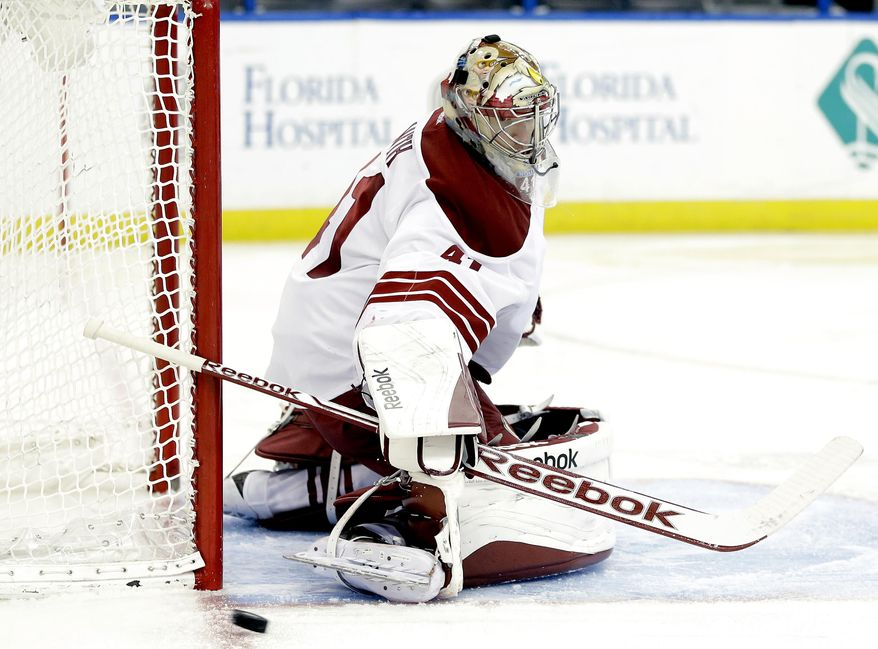 Phoenix Coyotes goalie Mike Smith (41) makes a save on a shot by the Tampa Bay Lightning during the second period of an NHL hockey game Monday, March 10, 2014, in Tampa, Fla. (AP Photo/Chris O'Meara)