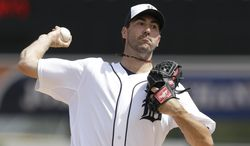 Detroit Tigers starting pitcher Justin Verlander throws during the first inning of a spring exhibition baseball game against the Toronto Blue Jays in Lakeland, Fla., Tuesday, March 11, 2014. (AP Photo/Carlos Osorio)
