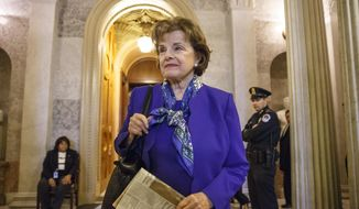 Senate Intelligence Committee Chair Sen. Dianne Feinstein, D-Calif. leaves the Senate chamber on Capitol Hill in Washington, Tuesday, March 11, 2014, after saying that the CIA's improper search of a stand-alone computer network established for Congress has been referred to the Justice Department. The issue stems from the investigation into allegations of CIA abuse in a Bush-era detention and interrogation program. (AP Photo/J. Scott Applewhite)