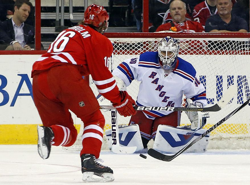 Carolina Hurricanes' Elias Lindholm (16) fires a shot at New York Rangers goalie Henrik Lundqvist during the first period of an NHL hockey game in Raleigh, N.C., Tuesday, March 11, 2014. (AP Photo/Karl B DeBlaker)