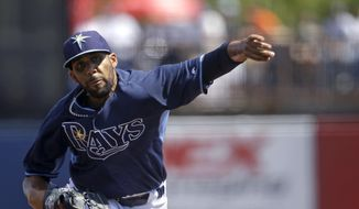 Tampa Bay Rays starting pitcher David Price pitches in the first inning of an exhibition baseball game against the Minnesota Twins in Port Charlotte, Fla., Tuesday, March 11, 2014. (AP Photo/Gerald Herbert)