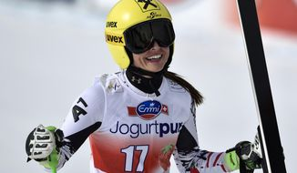 Anna Fenninger of Austria reacts during the women's downhill training session at the alpine skiing World Cup finals, in Lenzerheide, Switzerland, Tuesday, March 11, 2014. (AP Photo/Keystone, Peter Schneider)