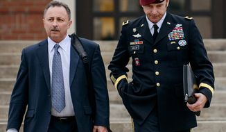 FILE - In this March 4, 2014, file photo, Brig. Gen. Jeffrey Sinclair, right, leaves the courthouse with his lawyers Richard Scheff, left, and Ellen C. Brotman, not pictured, following a day of motions at Fort Bragg, N.C. A military judge declined Monday, March 10, 2014, to dismiss sexual assault charges against Sinclair after reviewing what he said was evidence that political considerations influenced the military's handling of the case. (AP Photo/The Fayetteville Observer, James Robinson, File)