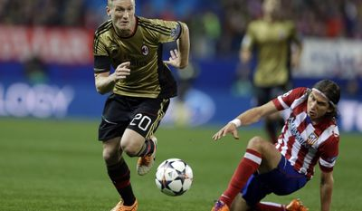 AC Milan's Ignazio Abate runs with the ball during a Champions League, round of 16, second leg, soccer match between Atletico Madrid and AC Milan at the Vicente Calderon stadium in Madrid, Tuesday March 11, 2014. (AP Photo/Paul White)