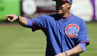 Chicago Cubs shortstop Javier Baez warms up before a spring exhibition baseball game against the San Francisco Giants in Scottsdale, Ariz., Monday, March 10, 2014. (AP Photo/Chris Carlson)