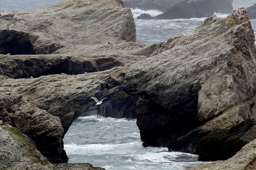 ** FILE ** This July 18, 2013, photo shows Arch Rock, one of the jewels of the newly protected coastline in Mendocino County near the town of Point Arena, Calif. (AP Photo/San Francisco Chronicle, Brant Ward)