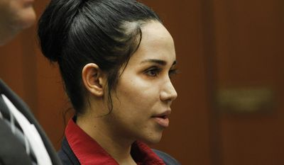 "Nadya Suleman, a single mother of octuplets and six other children, known as ""Octomom,"" appears briefly for arraignment Tuesday, March 11, 2014, in Los Angeles Superior Court. Suleman previously pleaded not guilty to three counts of welfare fraud stemming from an alleged failure to disclose about $30,000 in earnings from videos and personal appearances when she applied for aid last year. The latest count alleges Suleman wrongly collected an additional $10,000 in benefits from the state. Suleman gave birth to her octuplets in 2009. (AP Photo/Nick Ut)"