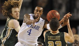 Delaware's Jarvis Threatt, center, and William and Mary's Tim Rusthoven, left, and Kyle Galliard  battle for the loose ball during the second half of an NCAA college basketball game for the CAA championship, Monday, March 10, 2014, in Baltimore. Delaware won 75-74. (AP Photo/Gail Burton)