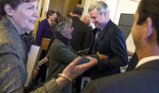 Senate Environment and Public Works Committee Chairman Sen. Barbara Boxer, D-Calif., talks with Sen. Sheldon Whitehouse, D-R.I., during a meeting of the Senate Climate Action Task Force prior to taking to the Senate Floor all night to urge action on climate change on Monday, March 10, 2014, in Washington. At left is Sen. Jeanne Shaheen, D-N.H. (AP Photo/ Evan Vucci)