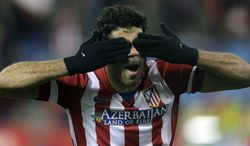 Atletico's Diego Costa celebrates scoring the opening goal during a Champions League, round of 16, second leg, soccer match between Atletico Madrid and AC Milan at the Vicente Calderon stadium in Madrid, Tuesday March 11, 2014. (AP Photo/Paul White)