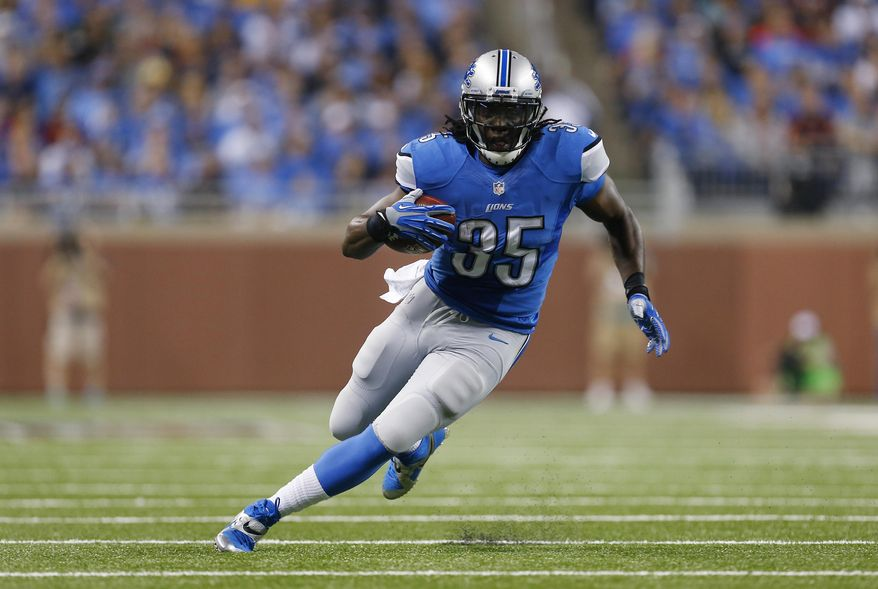 FILE - In this Sept. 29, 2013, file photo, Detroit Lions running back Joique Bell runs during the first quarter of an NFL football game against the Chicago Bears in Detroit. The Detroit Lions achieved one of their top goals this offseason by retaining Bell according to a person familiar with the negotiations. (AP Photo/Paul Sancya, File)