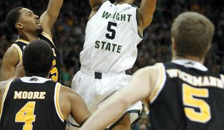Wright State's Miles Dixon (5) shoots during the first half of an NCAA college basketball game during the Horizon League men's tournament championship, Tuesday, March 11, 2014, in Dayton, Ohio. (AP Photo/The Dayton Daily News, Ty Greenlees)  LOCAL PRINT OUT; LOCAL TV OUT; WKEF-TV OUT; WRGT-TV OUT; WDTN-TV OUT (REV-SHARE)