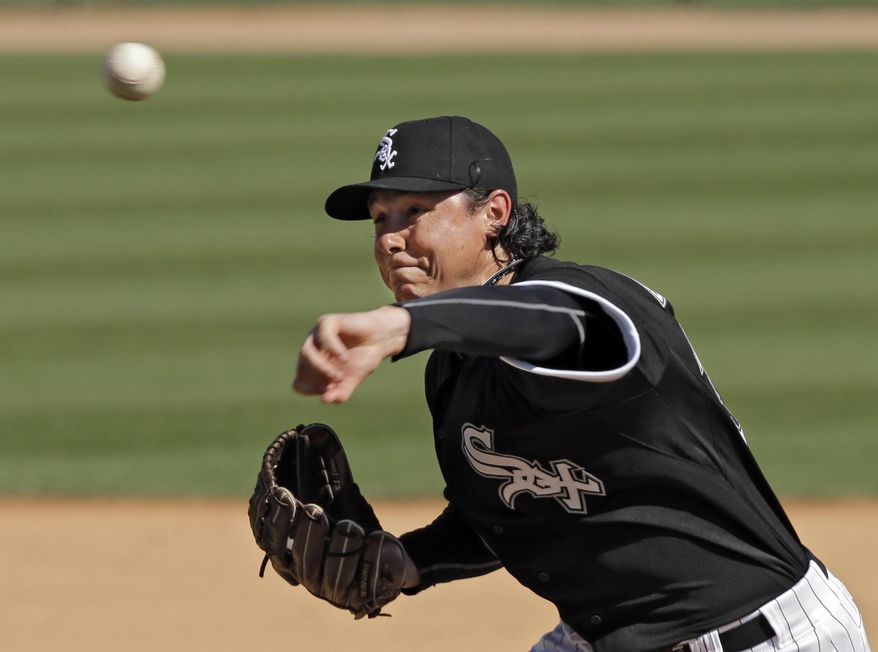 Chicago White Sox relief pitcher Scott Downs delivers against the Texas Rangers in the seventh inning of a spring exhibition baseball game Tuesday, March 11, 2014, in Glendale, Ariz. (AP Photo/Mark Duncan)