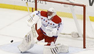 Washington Capitals goalie Jaroslav Halak, of Slovakia, makes a save against the Pittsburgh Penguins during the first period of an NHL hockey game, Tuesday, March 11, 2014, in Pittsburgh. (AP Photo/Keith Srakocic)