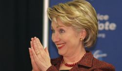 Sen. Hillary Rodham Clinton, D-N.Y., reacts to supporters as she campaigns for Democratic presidential candidate Sen. Barack Obama, D-Ill., at an American Federation of Teachers Union rally in Cincinnati Friday, Oct. 31, 2008. (AP Photo/Tom Uhlman)