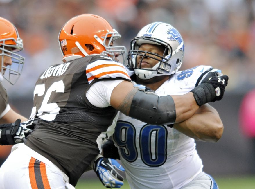 Detroit Lions defensive tackle Ndamukong Suh (90) tries to rush past Cleveland Browns guard Shawn Lauvao in the third quarter of an NFL football game Sunday, Oct. 13, 2013 in Cleveland. (AP Photo/David Richard)