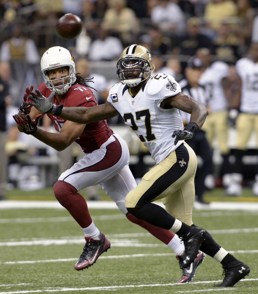 New Orleans Saints free safety Malcolm Jenkins (27) breaks up a pass intended for Arizona Cardinals wide receiver Larry Fitzgerald (11) in the second half of an NFL football game in New Orleans, Sunday, Sept. 22, 2013. (AP Photo/Bill Feig)