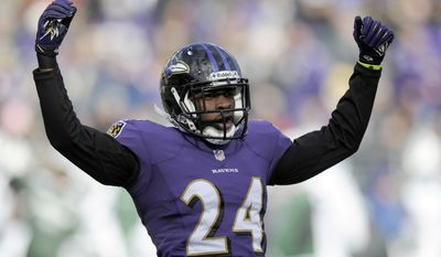 Baltimore Ravens cornerback Corey Graham reacts to a play during the first half of an NFL football game against the New York Jets in Baltimore, Md., Sunday, Nov. 24, 2013. (AP Photo/Nick Wass)