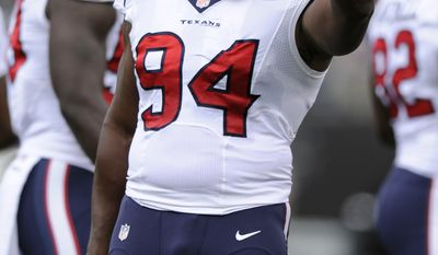 Houston Texans defensive end Antonio Smith points during a break in play in the first half of an NFL football game against the Baltimore Ravens, Sunday, Sept. 22, 2013, in Baltimore. (AP Photo/Nick Wass)