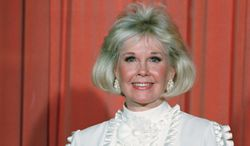 FILE - In this Jan. 28, 1989 file photo, actress and animal rights activist Doris Day poses for photos after receiving the Cecil B. DeMille Award she was presented with at the annual Golden Globe Awards ceremony in Los Angeles, Calif. Day is celebrating a landmark birthday with an auction to benefit her favorite cause: animals. A spokesman for Day said Tuesday, March 11, 2014, the nonprofit Doris Day Animal Foundation will mark her 90th birthday in April with a bash in Carmel, Calif. (AP Photo, file)