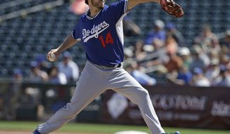 CORRECTS SPELLING OF SURPRISE - Los Angeles Dodgers starting pitcher Dan Haren throws during the first inning of an exhibition baseball game against the Kansas City Royals on Tuesday, March 11, 2014, in Surprise, Ariz. (AP Photo/Darron Cummings)