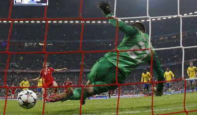 Arsenal's goalkeeper Lukasz Fabianski saves a shot from the penalty spot by Bayern's Thomas Mueller during the Champions League round of 16 second leg soccer match between FC Bayern Munich and FC Arsenal in Munich, Germany, Wednesday, March 12, 2014. (AP Photo/Matthias Schrader)