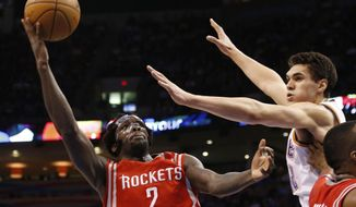 Houston Rockets guard Pat Beverley (2) shoots in front of Oklahoma City Thunder center Steven Adams duirng the second quarter of an NBA basketball game in Oklahoma City, Tuesday, March 11, 2014. (AP Photo/Sue Ogrocki)