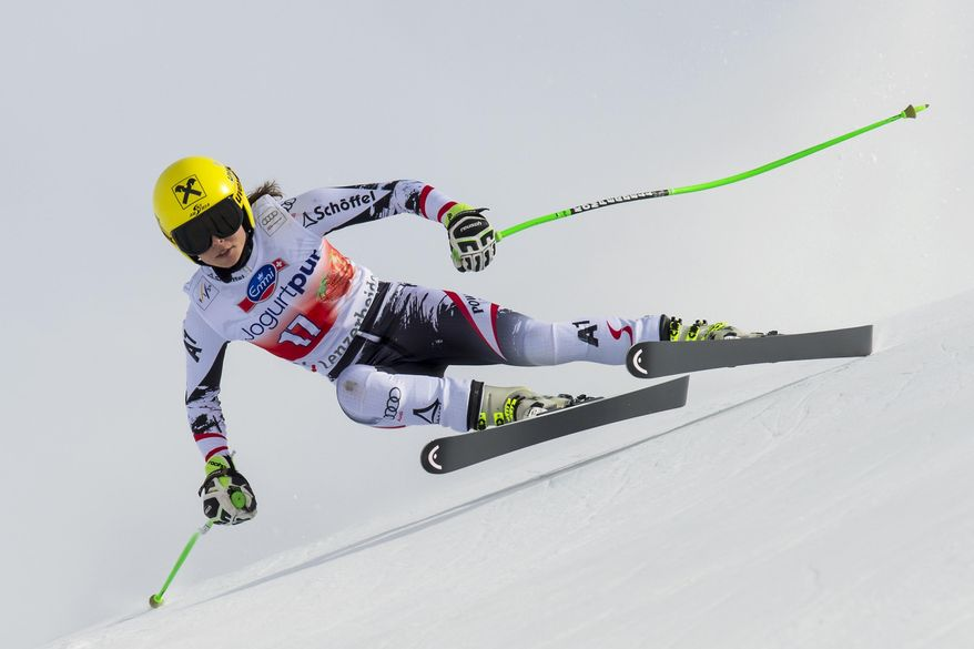 Anna Fenninger of Austria speeds down the course during the women's downhill training session at the alpine skiing World Cup finals, in Lenzerheide, Switzerland, Tuesday, March 11, 2014. (AP Photo/Keystone, Jean-Christophe Bott)