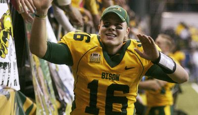 FILE - In this Dec. 20, 2013 file photo, North Dakota State quarterback Brock Jensen celebrates with fans following his team's 52-14 NCAA Football Championship Subdivision semifinal win over New Hampshire at the Fargodome in Fargo, N.D. Jensen, who is the winningest quarterback in NCAA Football Championship Subdivision history, is gearing up for his pro day in Fargo Wednesday, March 12, 2014, after being overlooked for the NFL combine. (AP Photo/Bruce Crummy, File)