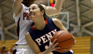 Penn guard Meghan McCullough, right, drives against Princeton guard Blake Dietrick during the first half of an NCAA college basketball game, Tuesday, March 11, 2014, in Princeton, N.J. (AP Photo/Julio Cortez)