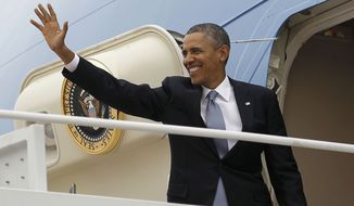 President Barack Obama waves as he boards Air Force One, Tuesday, March 11, 2014, at Andrews Air Force Base. Obama is traveling to New York for a pair of fundraisers for the Democrats. (AP Photo/Pablo Martinez Monsivais)