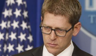 White House press secretary Jay Carney listens as he briefs reporters at the White House in Washington, Tuesday, March 11, 2014. Carney took questions about allegations that the CIA searched computers of congressional staffers. (AP Photo/Charles Dharapak)