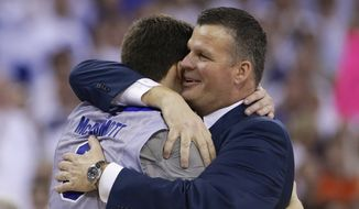 Creighton coach Greg McDermott hugs his son, Doug McDermott (3) after Doug scored his 3000th career point in the second half on an NCAA college basketball game in Omaha, Neb., Saturday, March 8, 2014. Doug McDermott scored a career-high 45 points and became the eighth player in Division I history to go over 3,000 for a career, and No. 13 Creighton rolled to an 88-73 victory over Providence on Saturday night. (AP Photo/Nati Harnik)