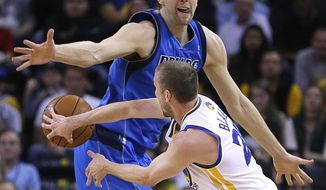 Golden State Warriors' Steve Blake, right, passes around Dallas Mavericks' Dirk Nowitzki, of Germany, during the first half of an NBA basketball game Tuesday, March 11, 2014, in Oakland, Calif. (AP Photo/Ben Margot)