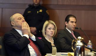 New Jersey Gov. Chris Christie's former Deputy Chief of Staff Bridget Anne Kelly, center, sits with her attorney Michael Critchley, left, and defense team member attorney Edmund DeNoia, right,  during a hearing Tuesday, March 11, 2014, in Trenton, N.J. Attorneys for Kelly and former Christie campaign manager Bill Stepien were in court to try to persuade a judge not to force them to turn over text messages and other private communications to New Jersey legislators investigating the political payback scandal ensnaring Christie's administration. (AP Photo/The Record of Bergen County, Chris Pedota, Pool)