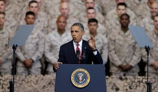 President Obama expresses appreciation to Marines for their service last summer. His administration's proposed budget, however, seems to send a different message. (Associated Press)
