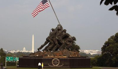 ** FILE ** This is a Sunday, Aug. 9, 2009, file photo of  the United States Marine Corps War Memorial, better known as the Iwo Jima Memorial, depicting one of the most historic battles of World War II, at the Arlington, Va. (AP Photo/Ron Edmonds, File)