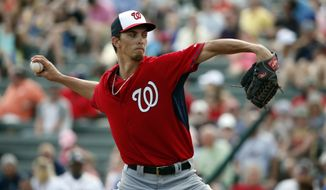 Washington Nationals starting pitcher A.J. Cole (69) throws in a spring exhibition baseball game against the Atlanta Braves, Tuesday, March 4, 2014, in Kissimmee, Fla. The Braves won 8-4. (AP Photo/Alex Brandon)