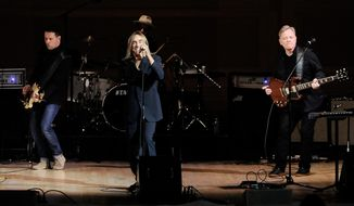 Singer Iggy Pop, center, performs with Bernard Sumner, right, and Tom Chapman from the band New Order at the 24th Annual Tibet House U.S. benefit concert at Carnegie Hall on Tuesday, March 11, 2014, in New York. (Photo by Evan Agostini/Invision/AP)