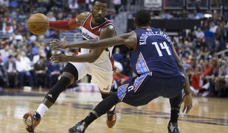 Charlotte Bobcats forward Michael Kidd-Gilchrist (14) defends Washington Wizards guard John Wall during the second half of an NBA basketball game Wednesday, March 12, 2014, in Washington. The Bobcats defeated the Wizards 98-85. (AP Photo/ Evan Vucci)