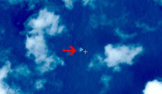 Planes sent Thursday to search the area where Chinese satellite images showed possible debris from the missing Malaysian jetliner found nothing, Malaysia's civil aviation chief said, deflating the latest lead in the six-day hunt. (China Resources Satellite Application Center)