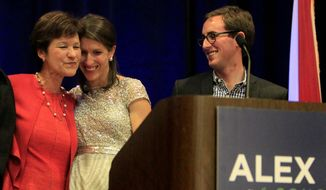 Alex Sink gets at a hug on stage from her daughter Lexi Crawford while delivering her concession speech, after being defeated by David Jolly for Florida's 13th Congressional District, at her watch party at the Hilton Carillon in St. Petersburg Tuesday evening March 11, 2014. On right is Lexi Crawford's husband Douglas Crawford.  (AP Photo/The Tampa Bay Times, Dirk Shadd)