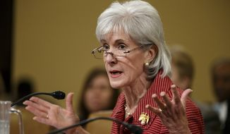 Health and Human Services Secretary Kathleen Sebelius defends President Barack Obama's healthcare law, the Affordable Care Act, as she answers questions from Republican members of the House Ways and Means Committee during its review of President Obama's budget requests, Wednesday, March 12, 2014, on Capitol Hill in Washington.  (AP Photo/J. Scott Applewhite)