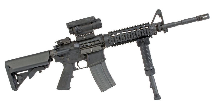 The M4 carbine is a family of firearms that was derived from earlier carbine versions of the M16 rifle, which was in turn derived from the original AR-15 rifle that Eugene Stoner designed and ArmaLite manufactured. The M4 is a shorter and lighter variant of the M16A2 assault rifle. It is a gas-operated, magazine-fed, selective fire, shoulder-fired weapon with a telescoping stock and 14.5 in (370 mm) barrel to ease close quarters combat. Like the rest of the M16 family, it fires the .223 caliber, or 5.56 mm NATO round.